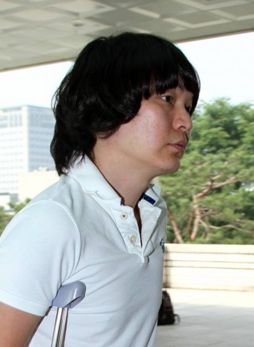 지난 2011년 공판에 참석하러 나타난 신정환 ⓒOSEN=이대선 기자