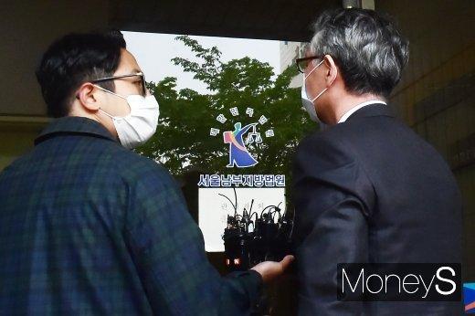 [머니S포토] 구속 갈림길에 선 문은상 신라젠 대표