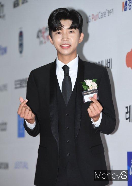 가수 임영웅이 지난해 10월 서울 중구 장충동 신라호텔에서 열린 '2020 올해의 브랜드 대상' 시상식에 참석했다. /사진=장동규 기자
