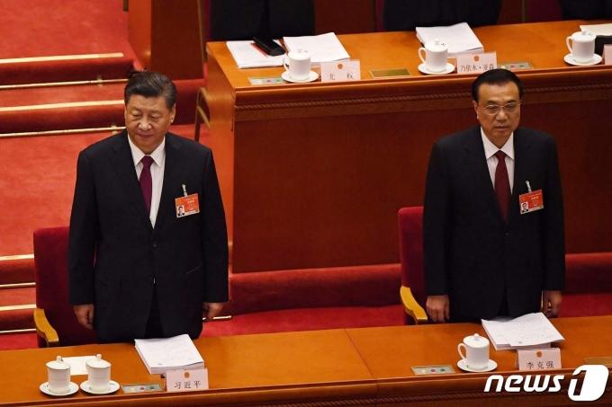 시진핑 중국 국가주석과 리커창 총리가 5일(현지시간) 베이징 인민대회당에서 열린 전국인민대표대회(전인대) 개막식에 참석을 하고 있다. © AFP=뉴스1 © News1 우동명 기자
