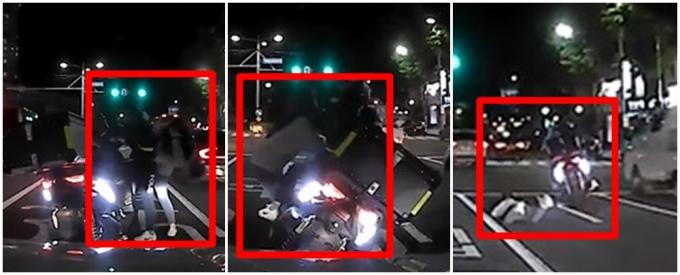 배달 기사와 한 여성이 도로에서 실랑이를 벌이다 큰 사고가 날뻔했다./ 사진=커뮤니티 캡처