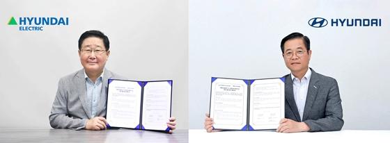 조석 현대일렉트릭 대표이사(왼쪽)와 김세훈 현대자동차 연료전지사업부 부사장이 '친환경 발전용 수소 연료전지 패키지 및 사업 개발'을 위한 업무협약을 체결하고 있다. /사진=현대일렉트릭